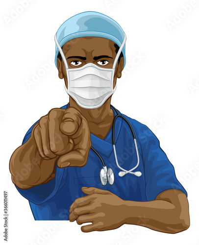 Obraz A doctor or nurse medical healthcare professional wearing scrubs uniform. Pointing at the viewer in a needs or wants you gesture with serious but caring look. Wearing PPE including face mask. - fototapety do salonu