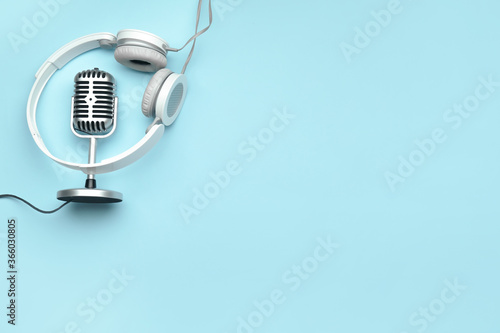 Obraz Headphones with microphone on color background - fototapety do salonu