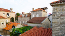 Houses With Red Tiled Roofs, Montenegro, Terracotta Tiles On The Roof.
