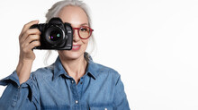 Smiling Stylish Senior Woman With  Digital Camera Portrait On White.  Tourism And Hobby.