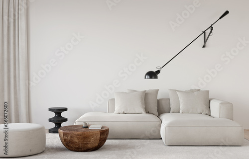 Fototapeta Stylish living room in beige tones with a sofa, a sconce, a wooden table, a marble side table and pouf obraz