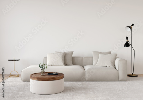 Fototapeta Living room in beige tones with a sofa, a floor lamp, a wooden table and a gold