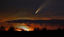 A Composite Of Comet Neowise As It Flies Overhead In The Summer Sky. A Composite Of Two Photos Taken Same Evening.