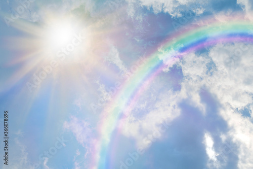 Summer sun burst and blue sky  rainbow - massive sun radiating beside fluffy clo Canvas-taulu