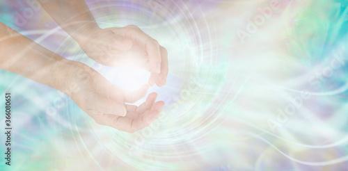 Carta da parati Sensing Vortex healing energy with hands - female cupped hands with a white spir