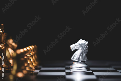Silver horse chess encounters with gold chess enemy on chess board and black background Canvas Print