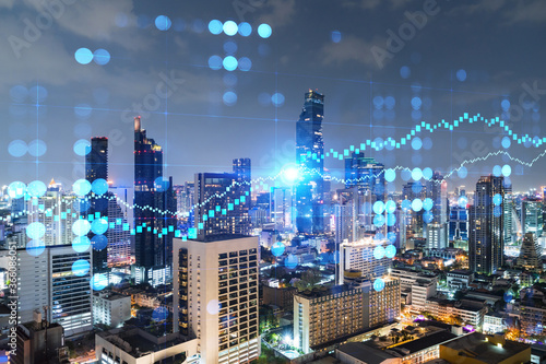 Fototapeta Night time view cityscape of Bangkok city background with financial graph. Success and finance concept. Multiexposure