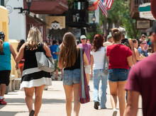 A Group Of Women Walk Through Historic St. Augustine, Florida On A Humid Summer Day.