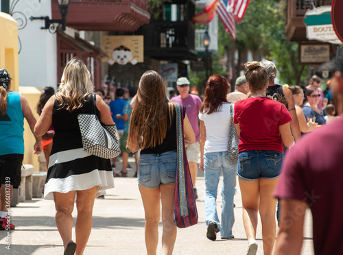 A group of women walk through historic St Canvas Print