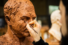 Hand Of Sculptor Finishing A C...