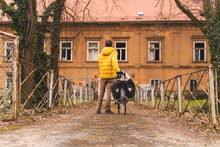 Establishing Shot Of Man Pushing A Bicycle In Abandoned Area, Croatia.