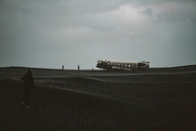 Young Female Hiker Walking Towards Famous Icelandic Plane Wreck