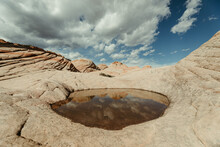 Post Rain Puddle And Reflection Of Red Rock Petrified Sand Dunes