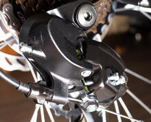 Gearshift On Mountain Bike MTB, Chain Moves On Rings. Changes Speeds. Shift Gears On Bicycle Crank. Work Of Chain Drive Chainset. Front Derailleur. Macro Closeup Low Angle Shot. Wheel Spins And Turns