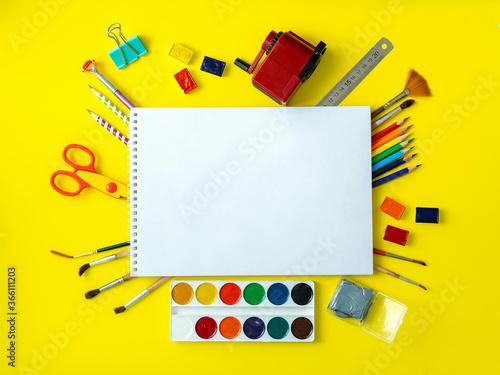 School album with school supplies on a yellow background Slika na platnu
