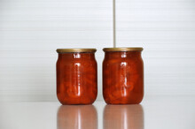 Two Glass Jars With Apricot Ja...