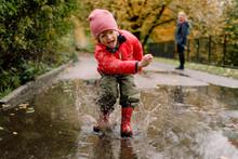 Playful Boy Splashing Water In...