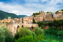 The Medieval Bridge And Fortified Old Stone City Of Besalu In The Foothills Of The Pyrenees, Besalu, Girona, Catalonia, Spain