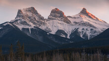 Evening Light On The Peaks Of Three Sisters Near Banff National Park, Canmore, Alberta, Canadian Rockies, Canada