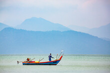 Fisherman On Small Boat, Strai...