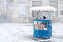 Traditional Krakow Bagel Seller In The Snow Located At The City Square, Krakow, Poland
