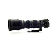 Modern DSLR Camera With Super Telephoto Zoom Lens On White