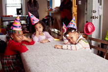 Bored Children Wearing Party H...