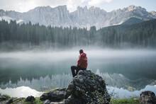 Switzerland, Young Man Sitting...