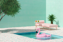 Pink Toy Flamingo Floating On Swimmingpool Next To Sunbed And Palm Trees