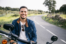 Smiling Young Biker Sitting On...