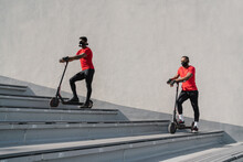 Sportsmen Wearing Face Masks With Scooters On Stairs