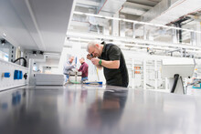 Man Examining Product In A Fac...