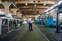 Senior Businessman In A Factory Hall