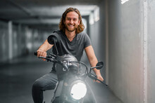Young Smiling Man On Motorcycle