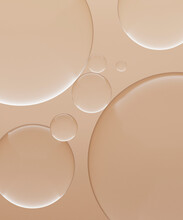 Three Dimensional Render Of Transparent Glass Spheres Against Light Brown Background