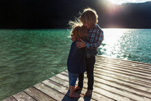 Brother Kissing Sister While S...