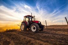 Man In Tractor Plowing Agricul...