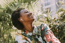 Happy Young Woman Listening Mu...