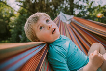 Cute Boy Looking Up While Rela...