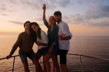 Friends Having Fun On A Yacht