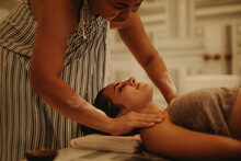 Woman Enjoying Massage At A Spa