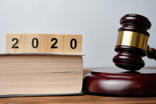 2020 On Wooden Cubes Next To The Judge Hammer