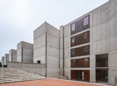 Obraz na płótnie concrete geometrical building on a cloudy day low angle