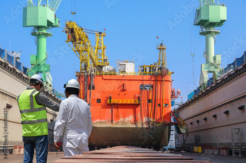 Valokuvatapetti Worker in shipyard for ship repair in floating dry dock yard for recondition mai