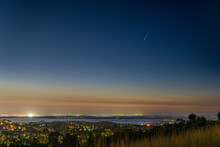 Comet NEOWISE In The Early Night Sky Over Folsom Lake In Folsom California.