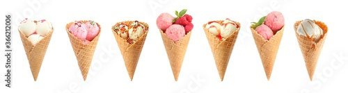 Fototapeta Set of different ice creams in wafer cones on white background
