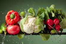 Various Fresh Raw Vegetables With Water Splash.