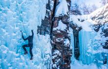 Climbing A Frozen Waterfall In...