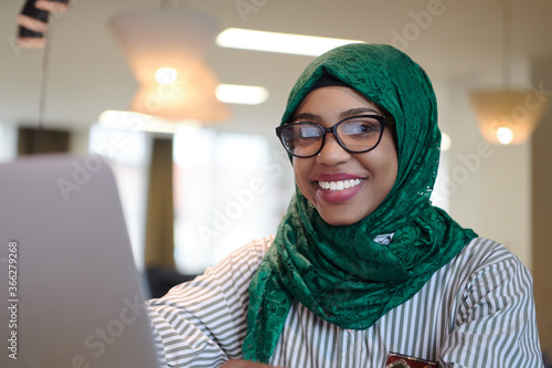 african muslim business woman working on laptop computer Fototapeta