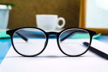 Black-rimmed Glasses In The Foreground